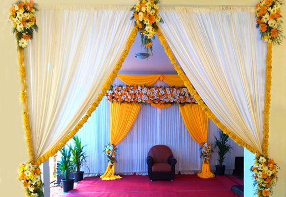 yellow stage arrangements & decor